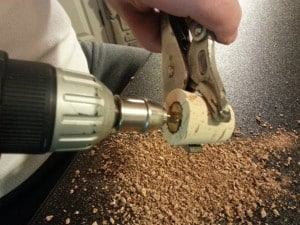 Completely through the cork with a stepped drill bit