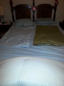 Folded sheets on a queen bed