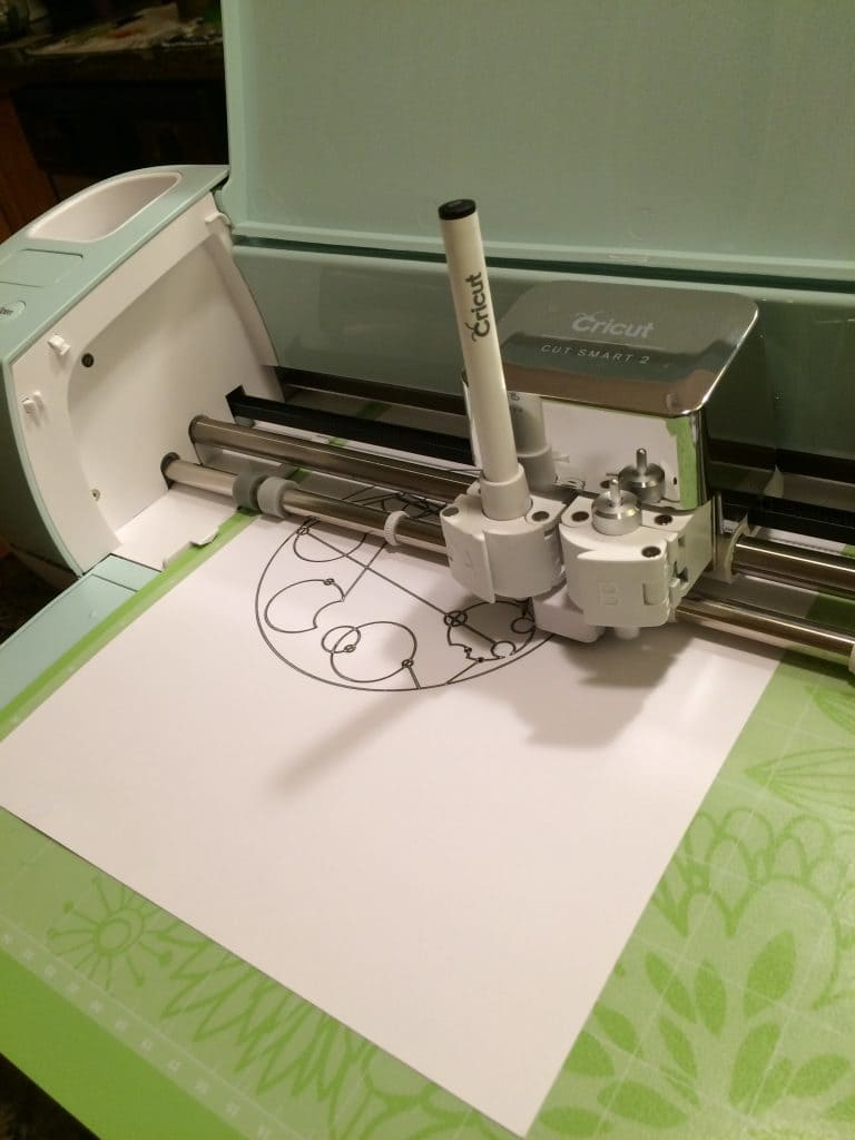 You can put a pen into the Cricut Explore Air 2 for writing